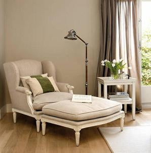 Arm chair and foot stool with open book on top