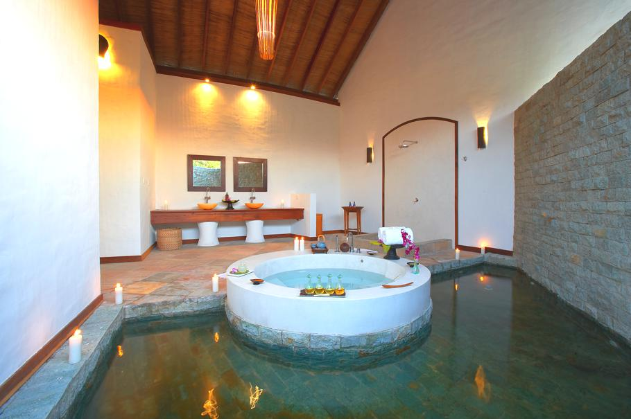Spa room with Jacuzzi hot tub and stone tiled relaxation pool