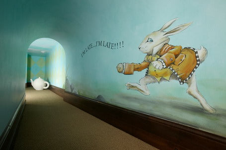 Alice in Wonderland themed corridor with White Rabbit and I'm late quote