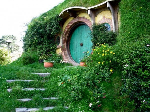 The front door of a house, in the style of a hobbit home