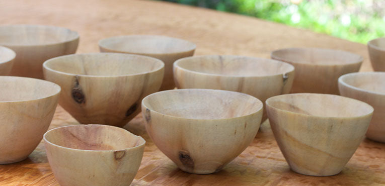 A selection of wooden bowls placed on a table top