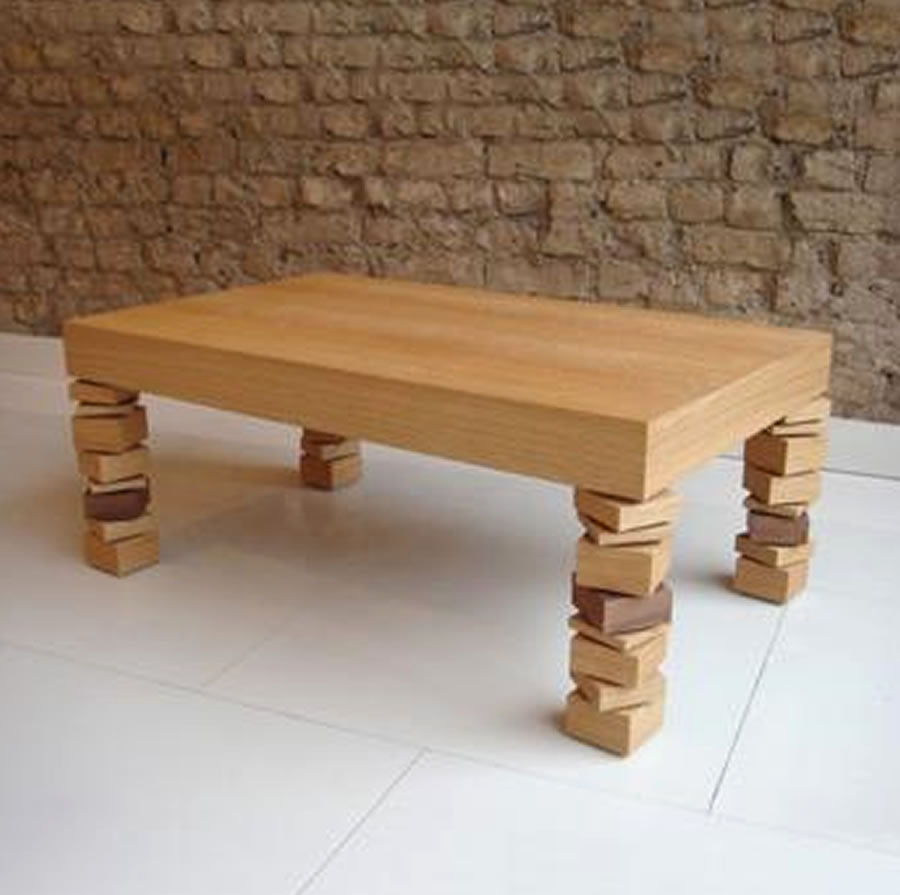 Light wooden table with legs made from a collection of wooden blocks irregularly grouped together