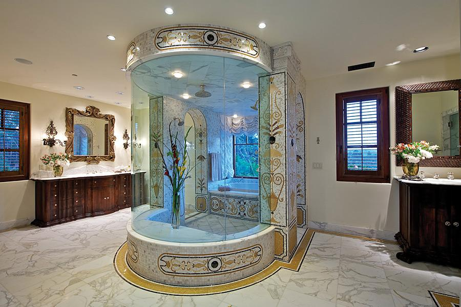 White mottled tiles with large walk in show and bathtub in a round glass pod