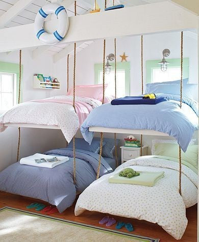Two Rope Style Bunk Beds Next To Each Other, With Nautical Themed Decor