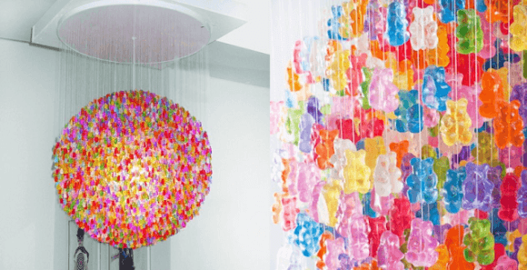 A colourful spherical light fixture, made from thousands of gummy bear sweets