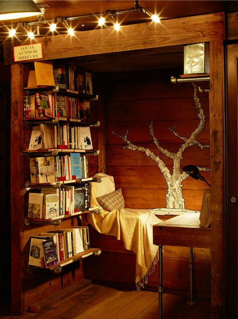 Very cosy reading nook in a dark wood fitted closet