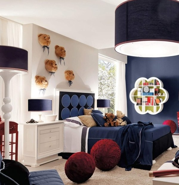 White and dark blue kids bedroom, with teddy bears on the bed and on the walls