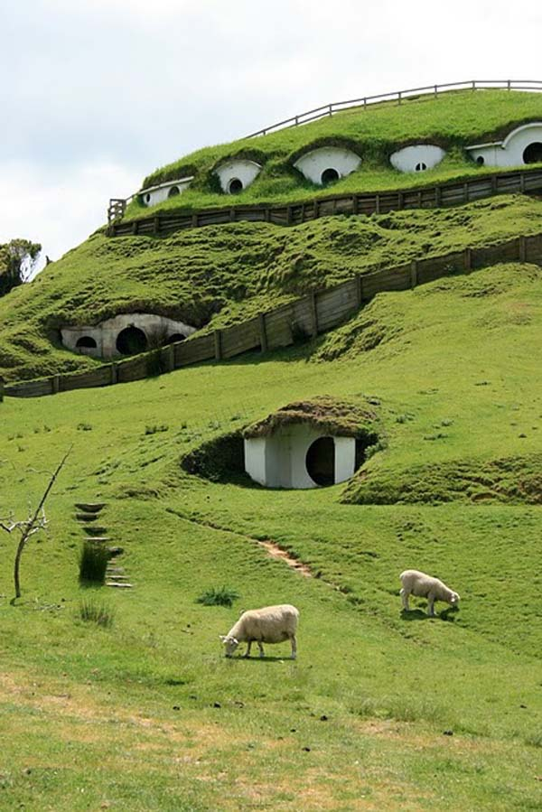 a grass covered hill then on closer inspection you see a number of white entrance ways into a building