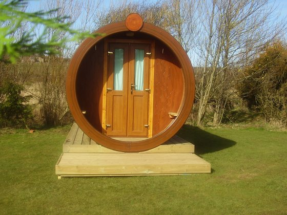 A round cylinder room mounted on a wooden platform