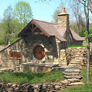 An old cottage style house with irregular stone walls
