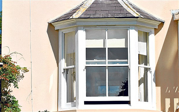 Small bay window on a peach coloured house