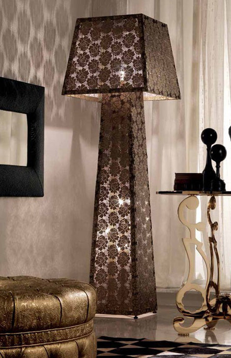 A tall floor lamp, with square base and brown patterned fabric sides