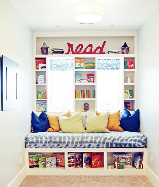 Reading nook and fold out bed in a small bedroom