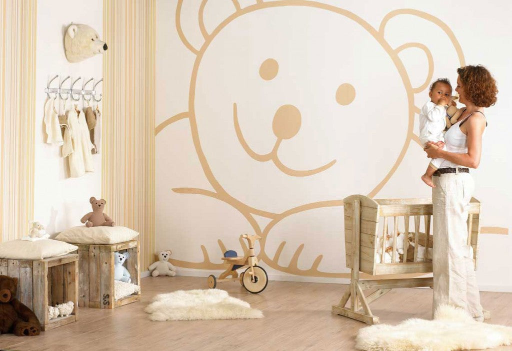 Beige and cream nursery bedroom with beige smiling bear decal outline on the wall
