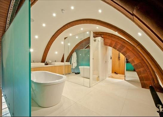 White curved ceiling bathroom with curved brown tile arches