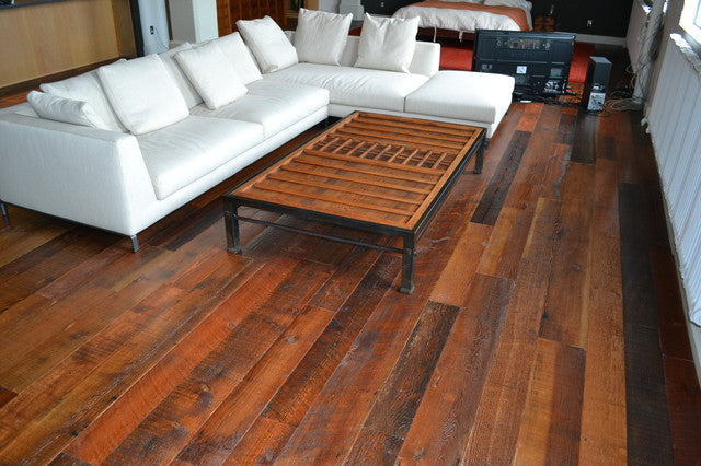 Dark wooden floor with white corner sofa