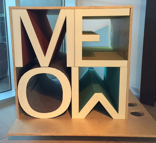 Two rows of two large wooden letters, spelling out MEOW