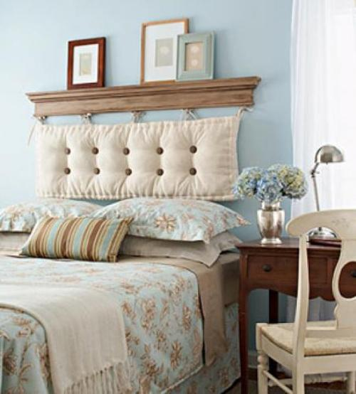 Duck egg blue bedroom with matching floral bedding and touches of cream and brown