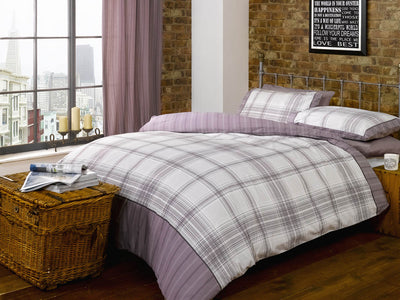 Grey and white checked bedding with hints of purple