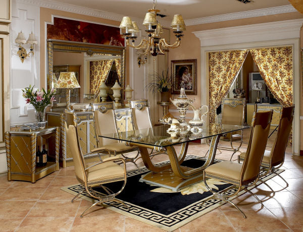 Luxury gold dining room with glass table and black rug