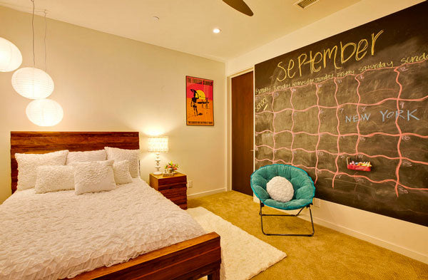 Cream bedroom with a chalk wall depicting a calendar for September
