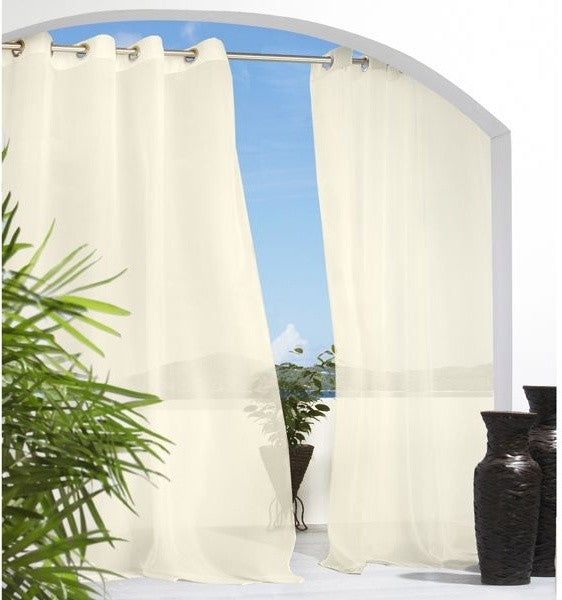 Cream voile curtains under a large arched doorway, with a Mediterranean feel