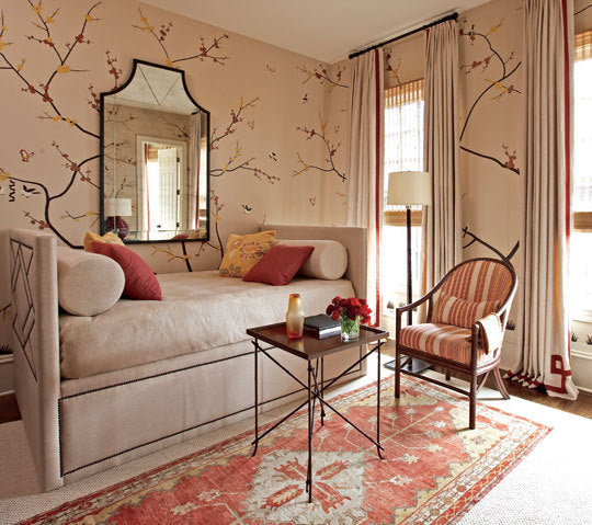 Cream living room with brown autumnal branches decal all over the wall
