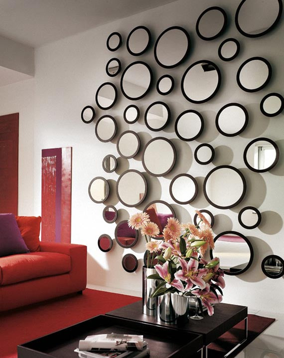 Lots of round mirrors on cream wall