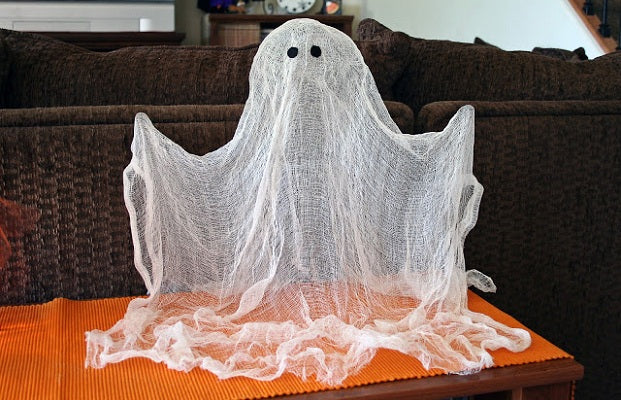 White voile ghost on a wooden side table