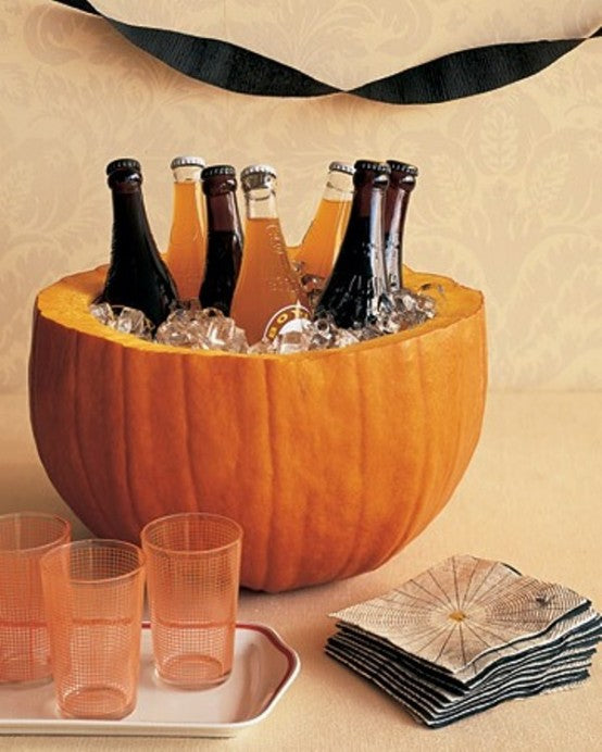 Pumpkin carved out to make an ice bowl for cooling bottled drinks