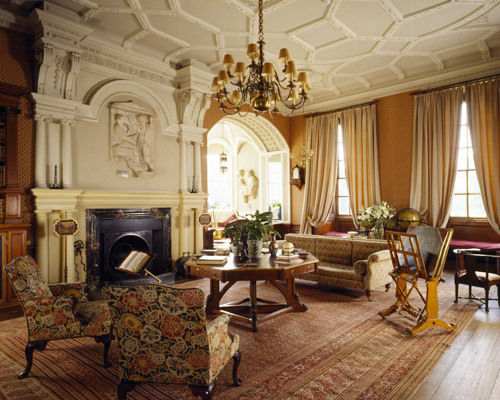 Grand Living Reception Room With Traditional Rugs, Wooden Floor And Original Architrave Ceiling And Marble Fireplace