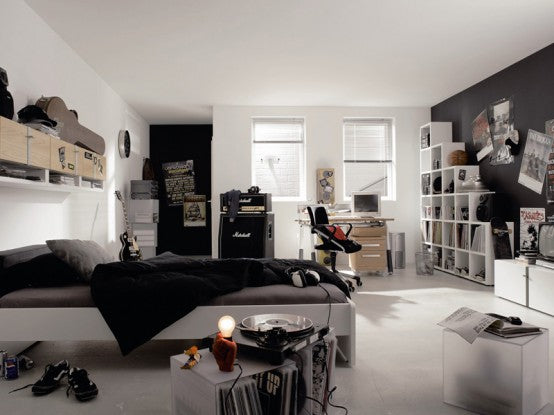 White and black bedroom with white storage units, a little messy
