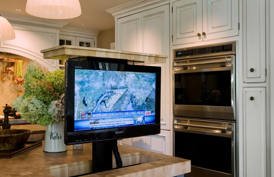 A TV that pops up out of a kitchen counter top