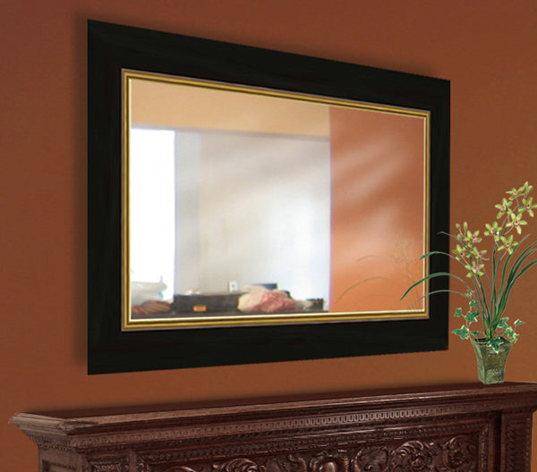 Mirror with a black frame on an orange wall
