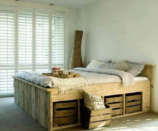 A rustic double bed made from upcycled wood, with wooden crate storage underneath