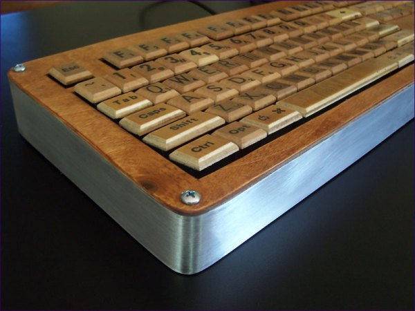 Retro computer keyboard with metal base and wooden top and wooden letters
