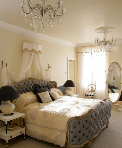 White and cream bedroom with luxury grey bed with cream bedding
