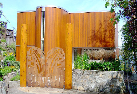 Wooden building with translucent garden gates with an intricate design