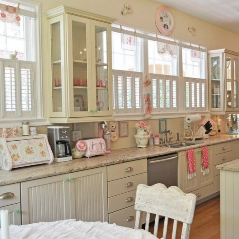 Cream kitchen with touches of pink throughout