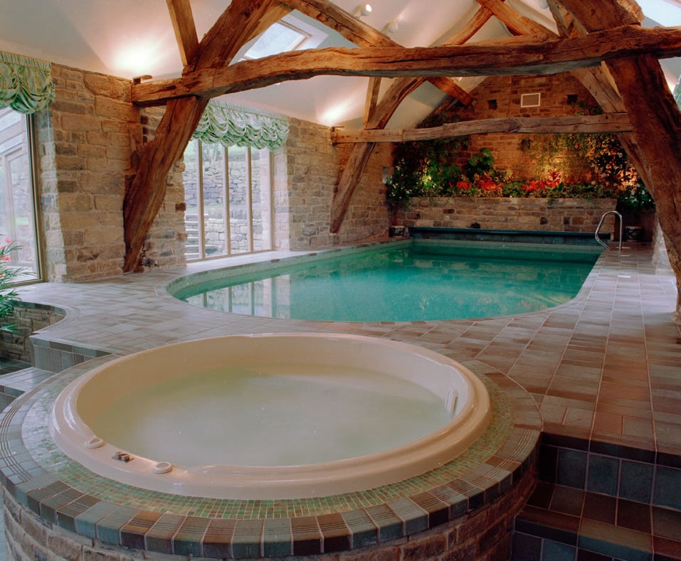 Exposed Brick In Luxury Swimming And Hot Tub Room
