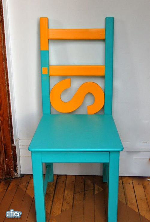 Turqoise and orange wooden chair, with the word Sit vertically in order to create the back support