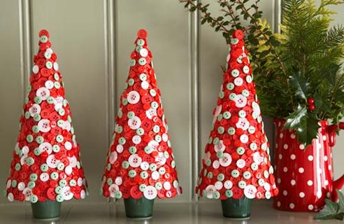 Red ornaments that look like Christmas trees covered in light green and pink buttons