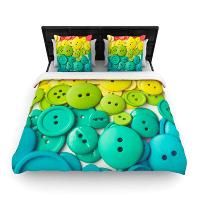 Double bedding on a bed, with a printed photograph design of different coloured buttons
