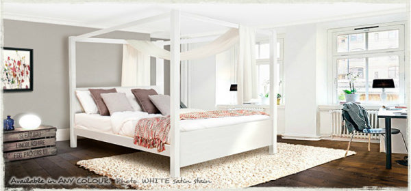White four poster bed in a grey and white bedroom