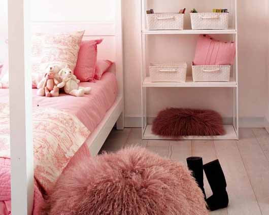Pink bedroom with pink bedding and fluffy pink beanbag