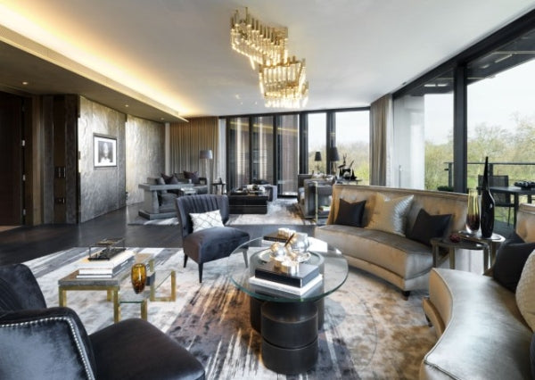 Stylish living room in black, gold, silver and grey with gold ceiling light fixture