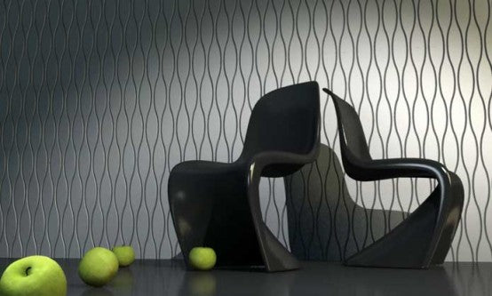 Funky black warped chairs in front of a black and white geometric patterned wall