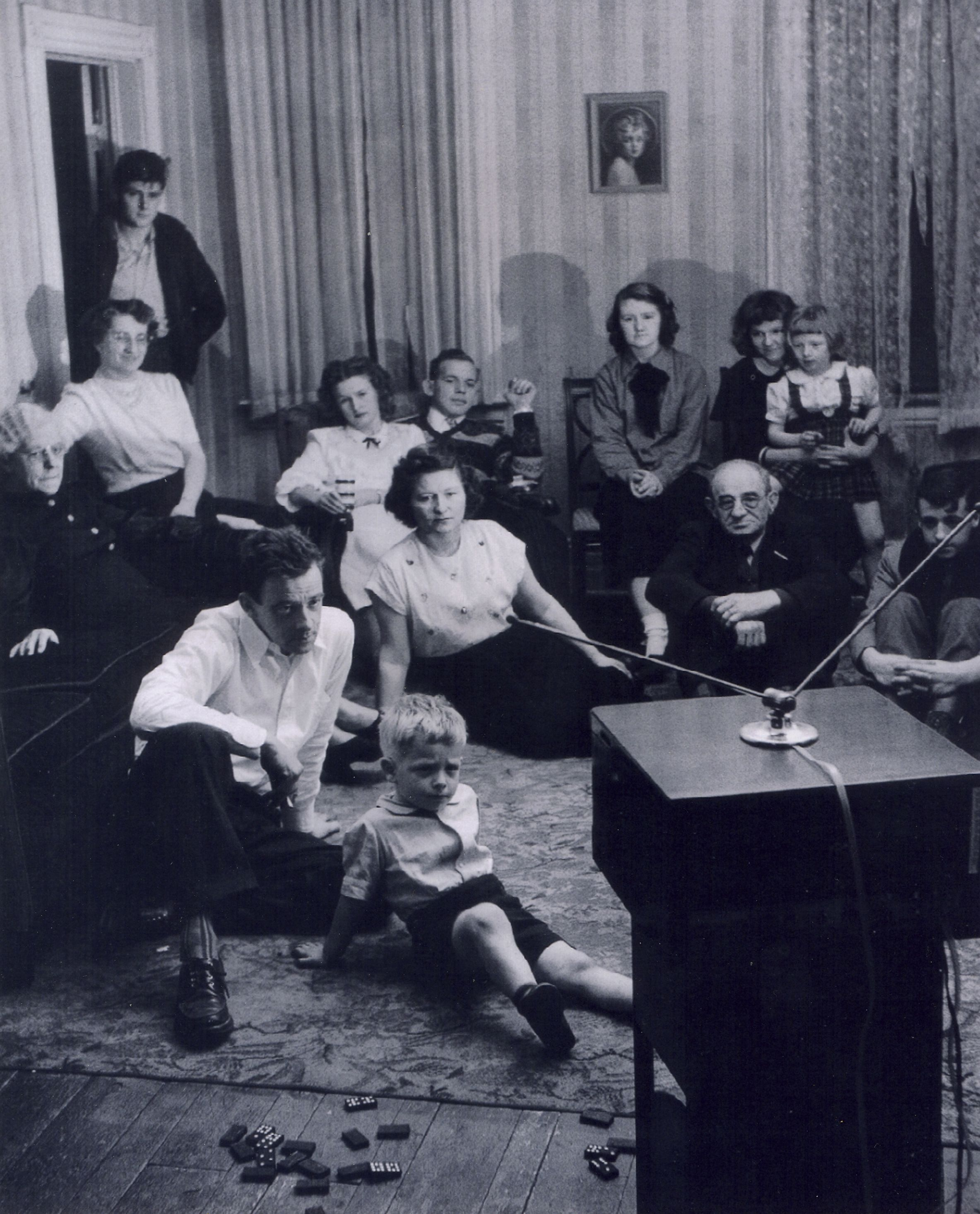 Family Sitting In Front Of An Early Televison