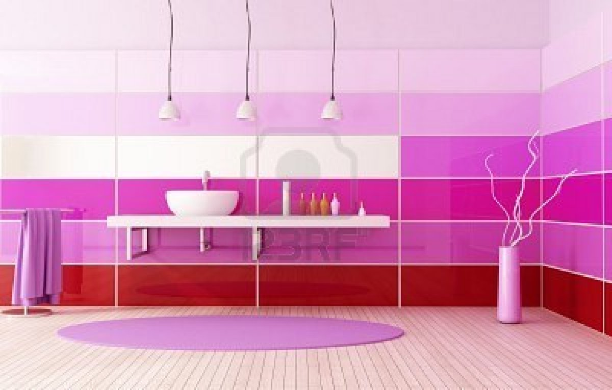 Large bathroom with striped wall panels, red at the bottom, fading up to purple pink and lighter pink towards the ceiling