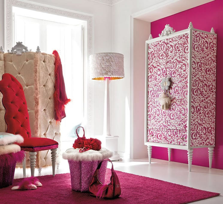 White dressing room with bright pink alcove, matching rug and wardrobe with a pink and white swirling pattern